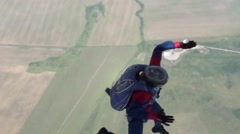 Skydiver jumps from airplane, freefall  and opens parachute Stock Footage