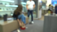 Blurred customer and shoe shop assistant. 4K background bokeh video Stock Footage