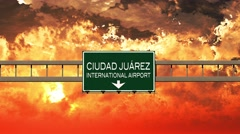 4K Passing Ciudad Juarez Airport Mexico Highway Sign in the Sunset Stock Footage