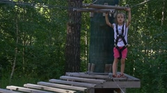 Girl Preparing For Descent to Wooden Platform Stock Footage