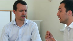 Two businessmen having discussion in office and gesticulate Stock Footage
