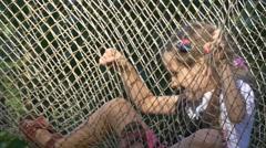 Fair-Haired School Girl Shakes a Hammock Stock Footage