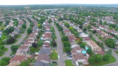 Slow Arial Descent over Suburbs Stock Footage