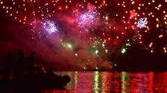 People in Boat Are Watching the Colored Fireworks Grand Pyrotechnics Show Light Stock Footage