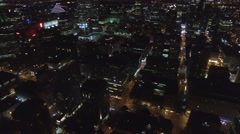 Drone filming and revealing large lit up city Stock Footage