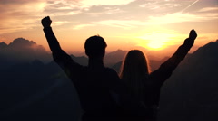 Achievement concept, edited - Embraced couple raises their arms Stock Footage
