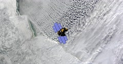 Top view of Earth-observing ICESat spacecraft in orbit above The Canadian Arctic Stock Footage
