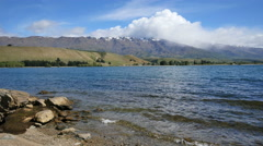 New Zealand Lake Dunstan with moraine and cloud Stock Footage