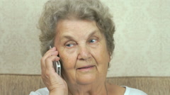 Old woman talking smartphone at home Stock Footage
