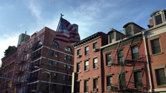 American Flag Flying by Apartment Buildings in New York's Little Italy Stock Footage