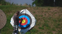 Target Archery: Young Archer Takes Arrows, Slow Motion, Stock Footage