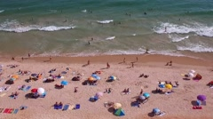 People in beach having sunbath - Falésia beach  Algarve Portugal Stock Footage