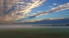 Spectacular dramatic morning sky, over foggy fields Stock Footage