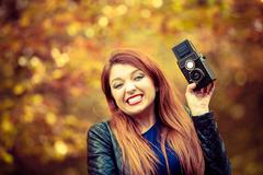 Red hair girl with analog camera. Stock Photos