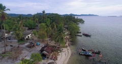 Aerial Flyover of Small Fishing Village on Remote Island in the Andaman Sea Stock Footage