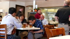 People eating foods inside Chinese restaurant with 4k resolution. Stock Footage