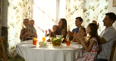 Happy multi generation family celebrating a birthday of grandmother and clapping - stock footage