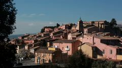 General view of Rousillon with ochre colored facades, Vaucluse, France Stock Footage