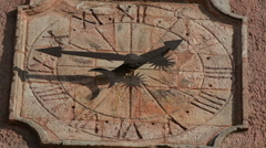 Old outdoor wall clock with moving hand clockwise, Roussillon, France Stock Footage