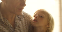Grandfather holding and playing with little grandchild. Old man with cute kid Stock Footage