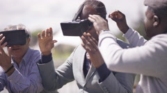 4K Mixed ethnicity senior men in the park trying out virtual reality viewer Stock Footage