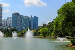 Timelapse of Fountains In Perdana Lake With Trees All Over Stock Footage