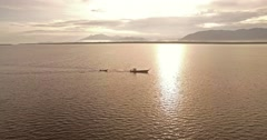 Traditional Thai Fishing Boats Returning Home at Sunrise in the Andaman Sea Stock Footage