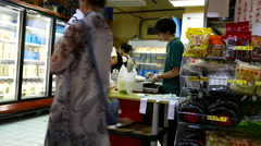Motion of people paying food by cash inside Chinese supermarket Stock Footage
