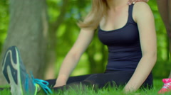 Fit girl stretching in park. Closeup of blonde woman expressing negative emotion Stock Footage