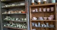 Ceramic polychrome decorated dishes in Russian national traditions on the shelf Stock Footage