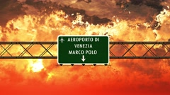 4K Passing Venice Airport Italy Highway Sign in the Sunset 2 Stock Footage