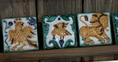 Three painted ceramic tile, mythological creatures, shop Suzdal Stock Footage