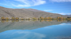 Reflection of autumn hills in the river/lake somewhere in Twizel, New Zealand. Stock Footage