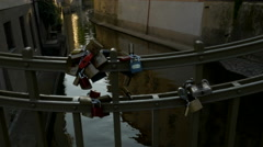 Love locks on railings below the Charles Bridge Stock Footage
