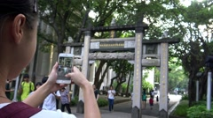 4K Playing Pokemon Go on App in Asia Chinese Archways, Paifang. used phone-Dan Stock Footage
