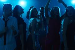 Group of posh friends dancing at party Stock Photos
