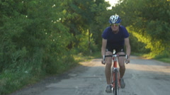 Cyclist riding mountain bike on trail at evening Stock Footage