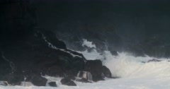 Waves crash against a rocky shore in extreme slow motion. Stock Footage