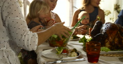 Portrait of happy multi generation family gathered at festive table and eating Stock Footage