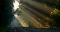 Sun rays shine down beautifully onto a highway or road. Stock Footage