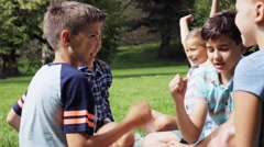 Happy kids playing rock-paper-scissors game Stock Footage