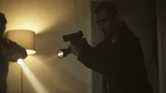 4K Special police officers with handguns & flashlights raiding dark apartment Stock Footage