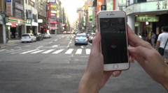 4K Asian woman playing Pokemon Go on App. Asia city street, used smart phone-Dan Stock Footage