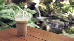 Iced Coffee Outdoors, Clear Spring Water Stock Footage