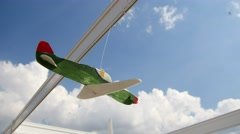 Model aircraft on display hanging on against sky Stock Footage
