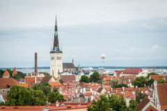 Air balloon flying ower old Tallinn in Estonia Stock Photos