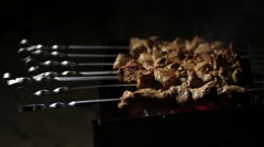 Female cooking meat skewers on the barbecue coals Stock Footage