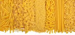 Assortment of uncooked italian pasta on a white Stock Photos