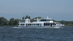 Pleasure cruise boat traveling the river Stock Footage