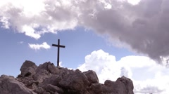 Mountain Cross over withe rocks in the Dolomites - Threatening Clouds Stock Footage